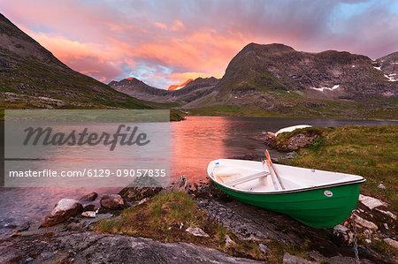 Trollstigen, Norway. Sunset with boat near the Troll Road.