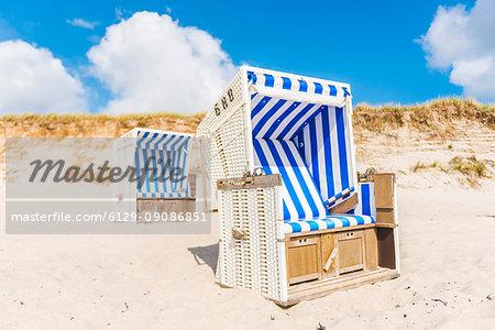 Hörnum, Sylt island, North Frisia, Schleswig-Holstein, Germany. Strandkorbs on the beach.