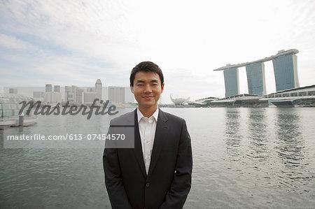 Asian Businessman smiling at Marina Bay