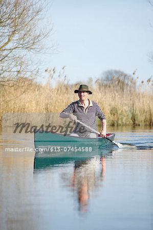 Man in canoe on river.