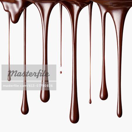 Chocolate falling in drops
