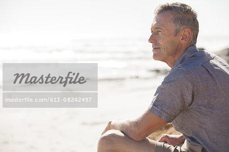 Mature man relaxing on beach