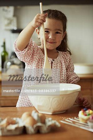 Portrait of little girl baking