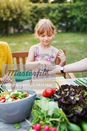 Girl Tasting Fresh Berries