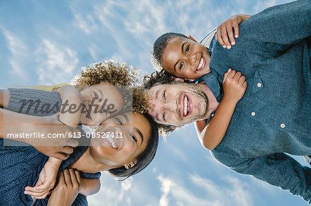 Portrait of happy parents piggybacking children
