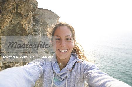 Self portrait of woman on rocky coastline.