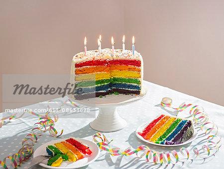 still life of birthday cake on table.