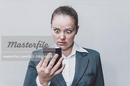 Businesswoman looking surprised.