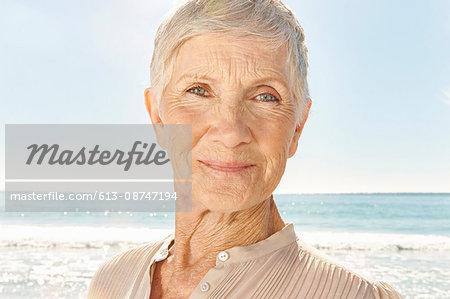 Senior woman on the beach, portrait