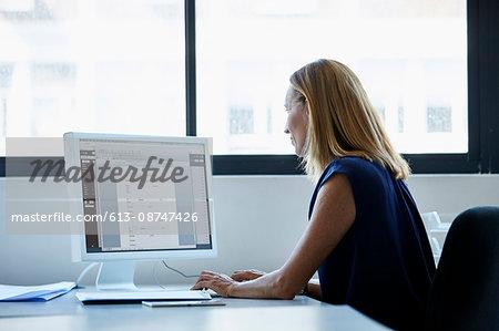 Businesswoman using computer at desk