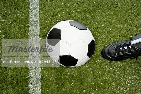 Kicking football