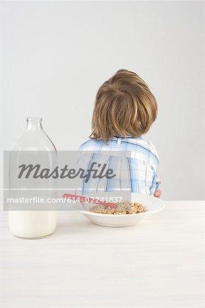 Boy turning back on breakfast