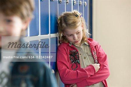 sad girl in school corridor stock photo masterfile premium