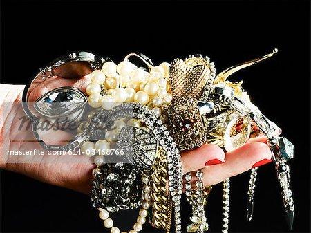 Woman holding jewelry
