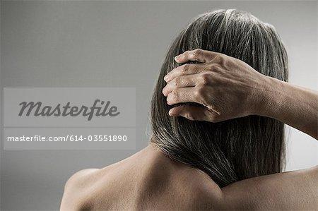 Topless senior woman, rear view