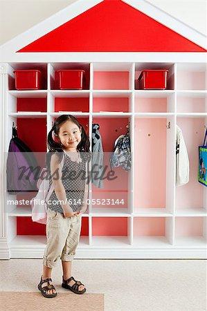Girl in school cloakroom