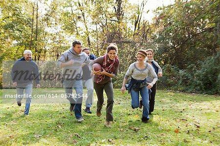 Mature friends playing football