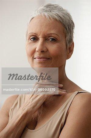 Senior woman smiling, portrait