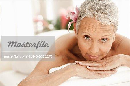 Senior woman relaxing on massage table, portrait