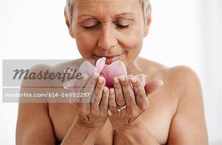 Senior woman holding flower