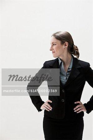 Young businesswoman looking away, studio shot