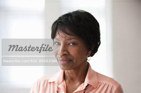 Portrait of African American mature woman, studio shot