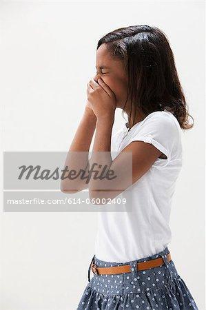 African American girl laughing, studio shot