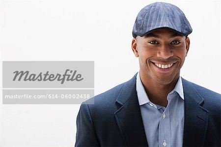 Portrait of African American man wearing cap, studio shot