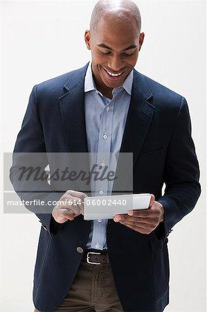 African American man using digital tablet, studio shot