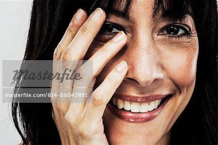 Mature woman touching face