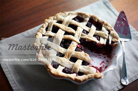 Blackberry pie with missing slice