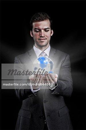 Man holding holographic globe