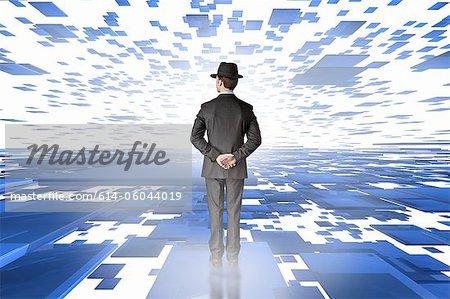 Businessman in a plane of digital panels