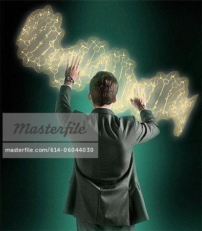 Man manipulating holographic genome