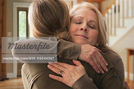 Mother embracing adult daughter