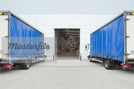 Trucks parked outside distribution warehouse