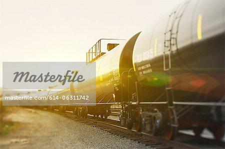 Railroad tanker cars in sunlight