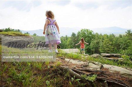 Girls playing on rocks