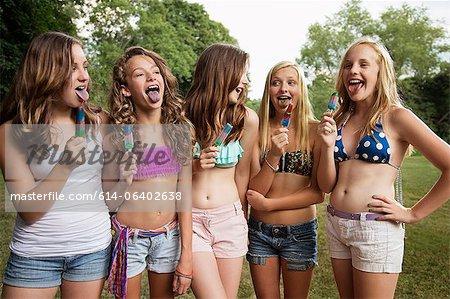 Girls eating ice lollies