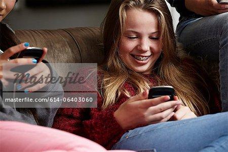 Teenage girls using smartphones