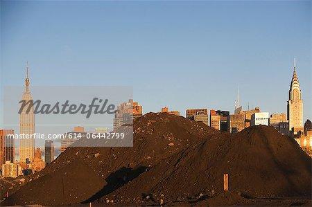 Pile of soil in front of Manhattan skyline, New York City