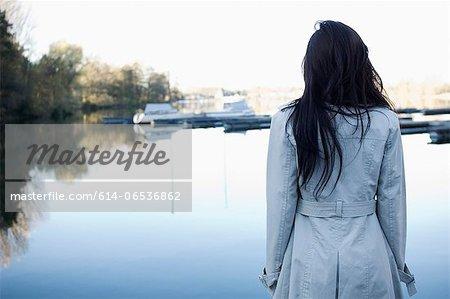 Woman overlooking still lake