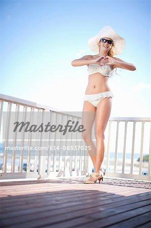 Woman wearing bikini on wooden deck