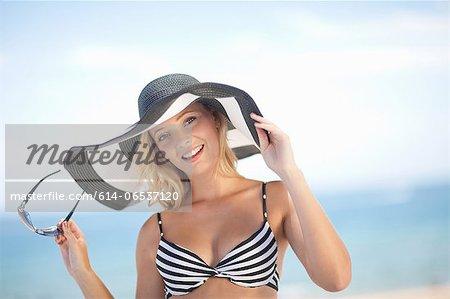 Woman wearing bikini and floppy hat