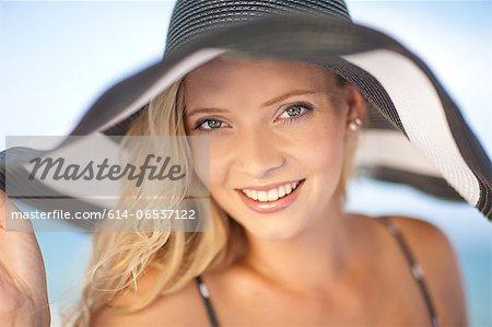 Woman wearing floppy hat outdoors