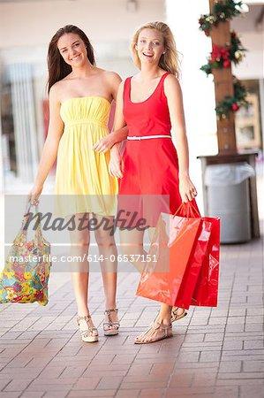 Women carrying shopping bags in mall