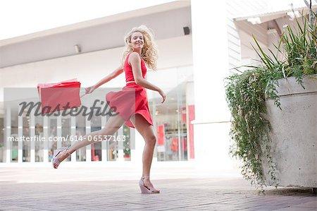Woman carrying shopping bag outdoors