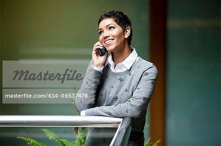Businesswoman talking on phone in office
