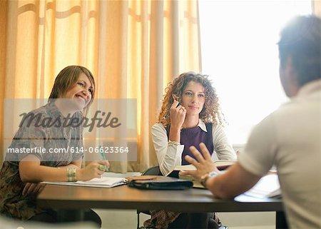 Students studying together at desk