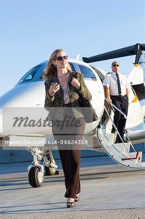 Businesswoman on airplane runway